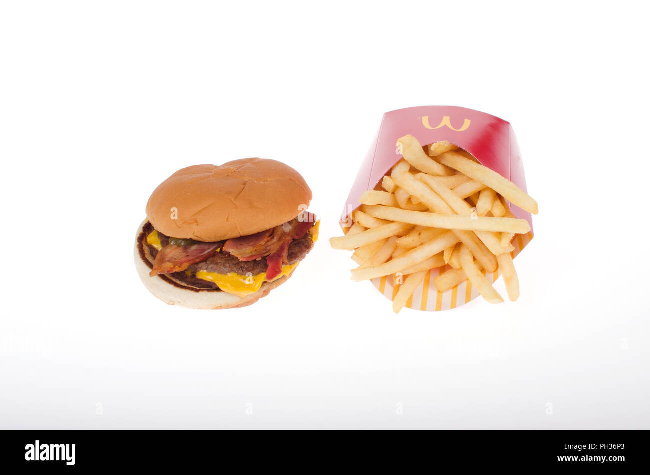 McDonalds Bacon McDouble Cheeseburger with french fries - Stock Image
