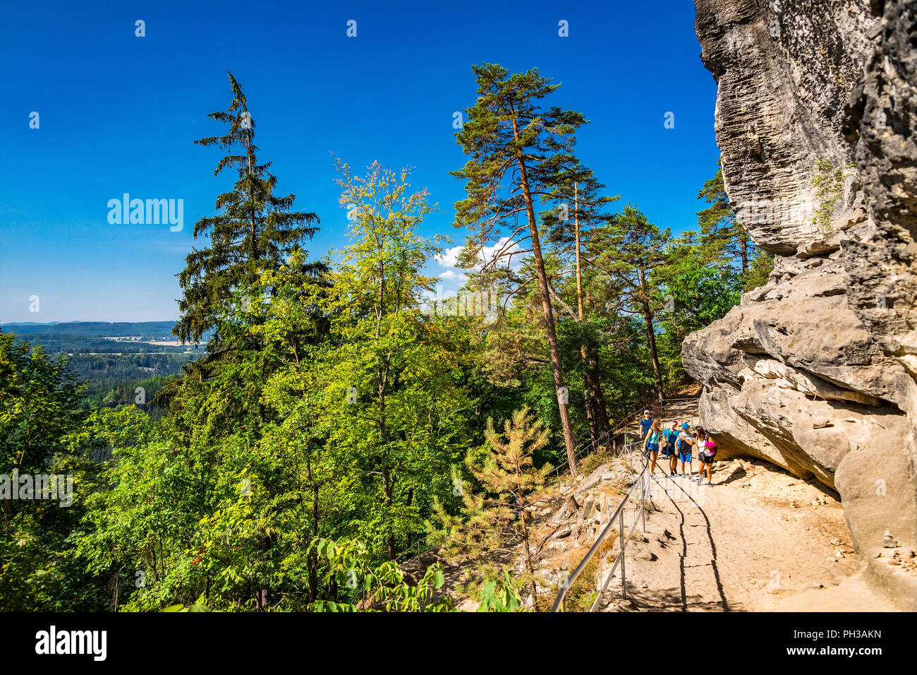 Hikers along the trail to Pravčická brána in Bohemian Switzerland, a picturesque region in the north-western Czech Republic. - Stock Image