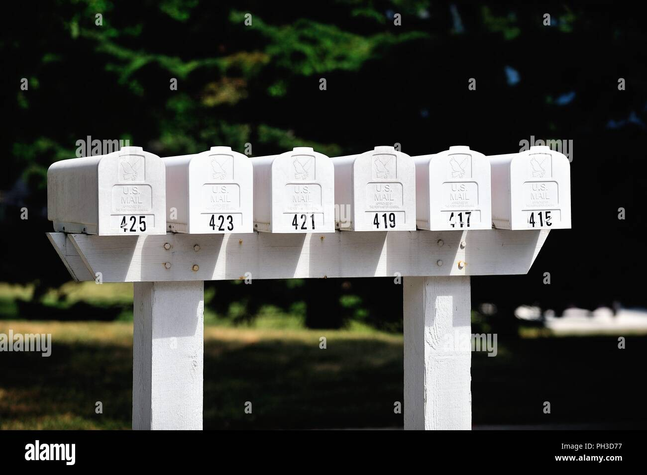 Bartlett, Illinois, USA. A series of mailboxes mounted together along a cul-de-sac surrounded by townhouses. - Stock Image