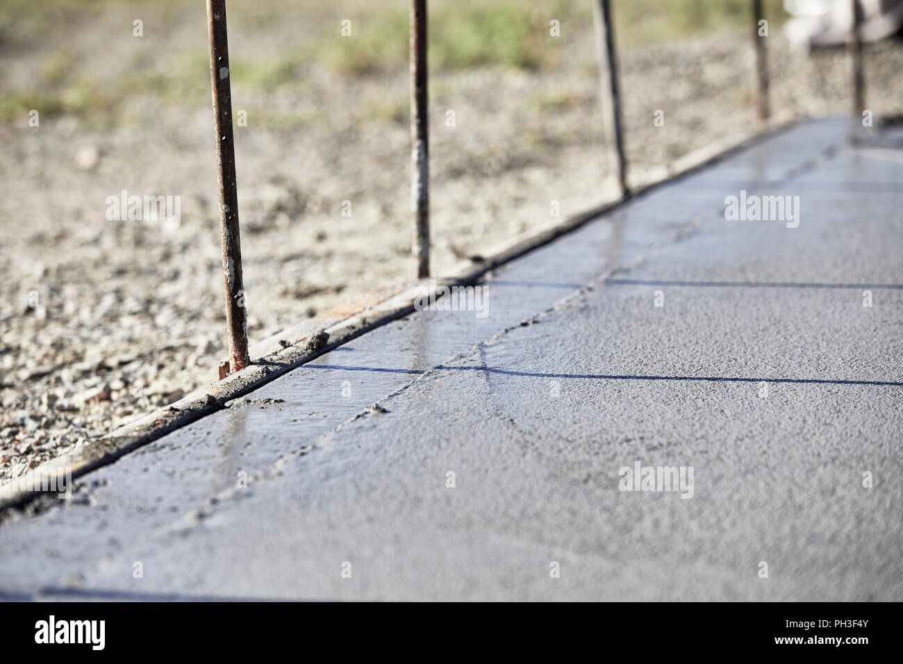 A wet concrete slab with a newly edged side and shallow depth of field Stock Photo