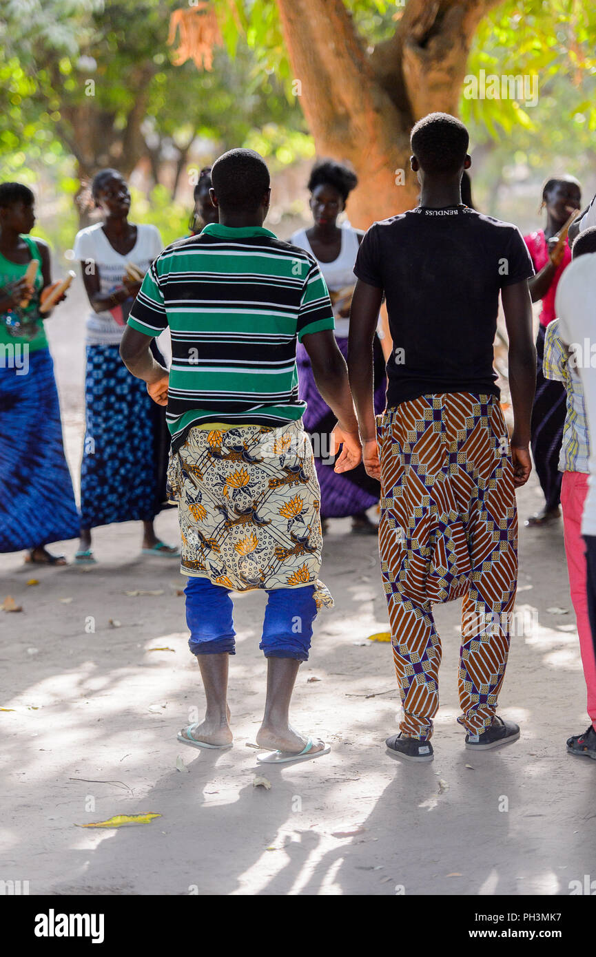Kaguit vil., SENEGAL - APR 30, 2017: Unidentified Diola men wear skirts during a traditional dance Kumpo in a Sacred Forest near Kaguit village - Stock Image