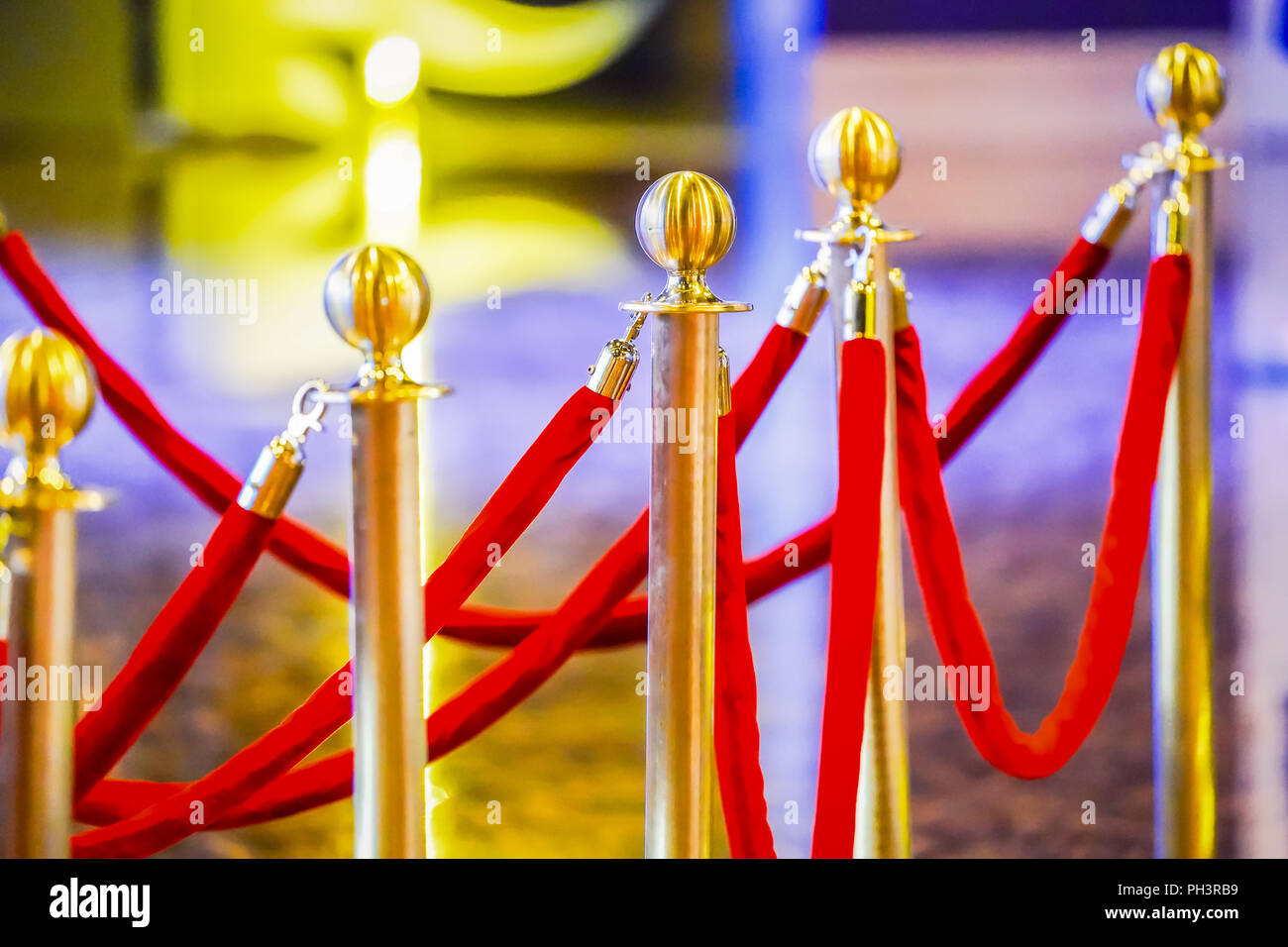 luxury ball head gold pole barricade with red velvet. - Stock Image