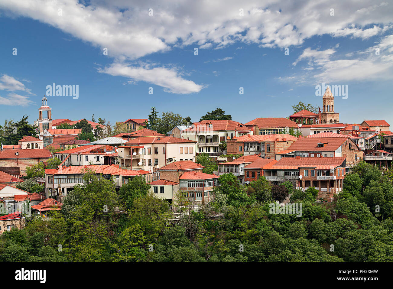 Traditional houses with red roof tiles in the city of Sighnaghi, in Georgia, Caucasus - Stock Image