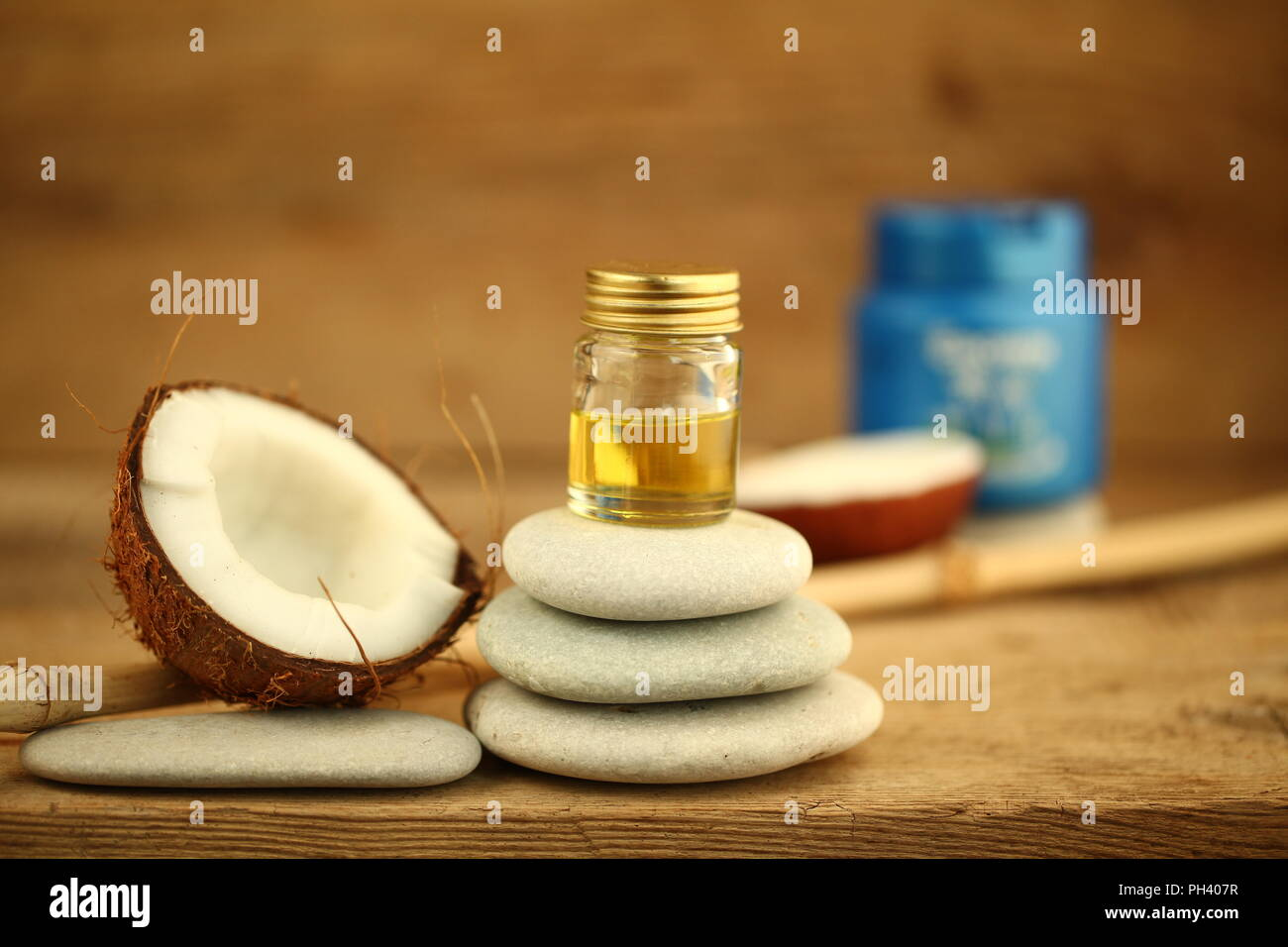 coconut oil for massage pebble candle Stock Photo