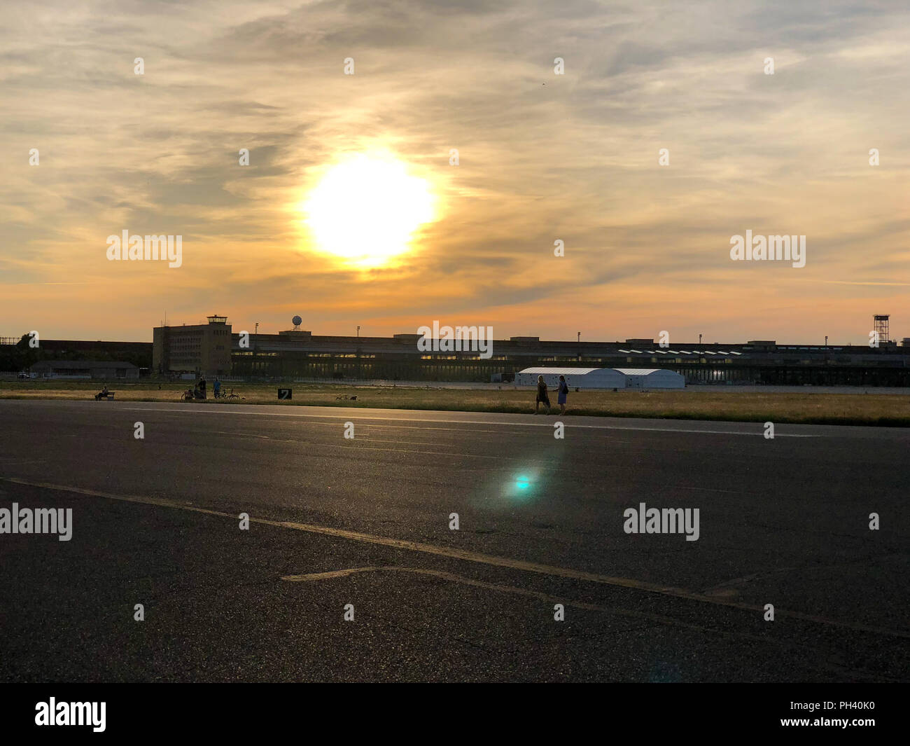 Summer sunset at Tempelhofer Feld, a park at a former airport in Berlin, Germany in 2018. - Stock Image