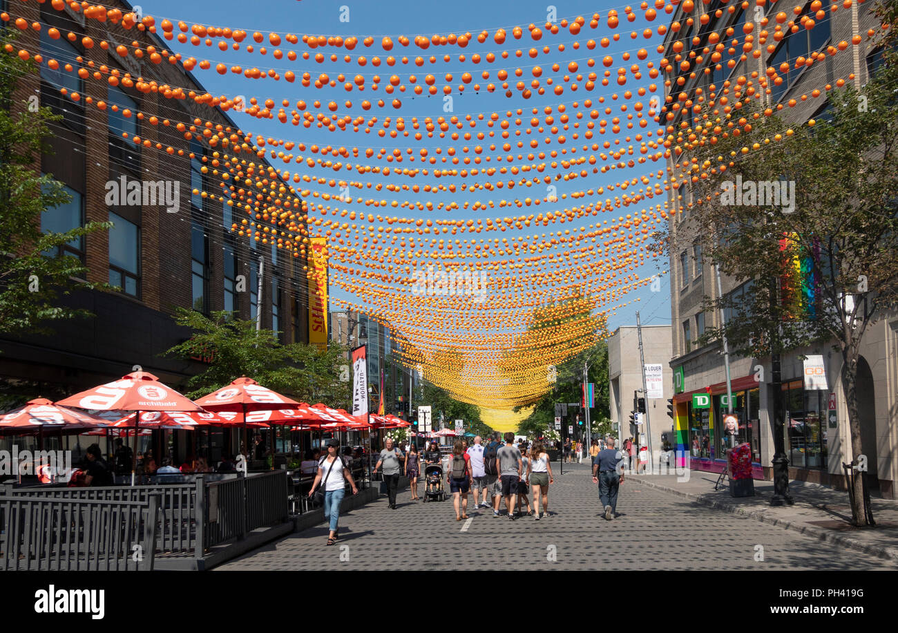 Decorations and no traffic in Gay Village on Rue Sainte-Catherine in Montreal, QC, Canada - Stock Image