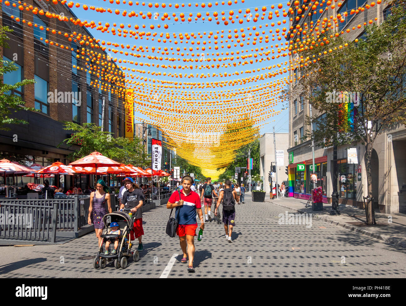 Decorations and no traffic in Gay Village on Rue Sainte-Catherine in Montreal, QC, Canada Stock Photo