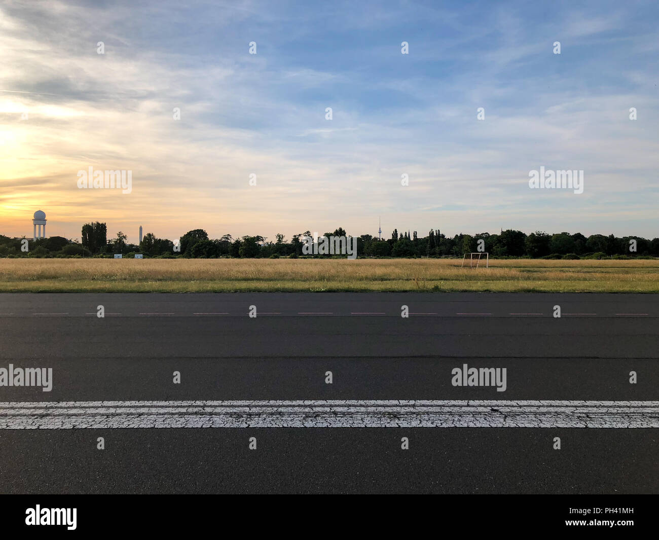 View from Tempelhofer Feld towards the Berlin city center. - Stock Image