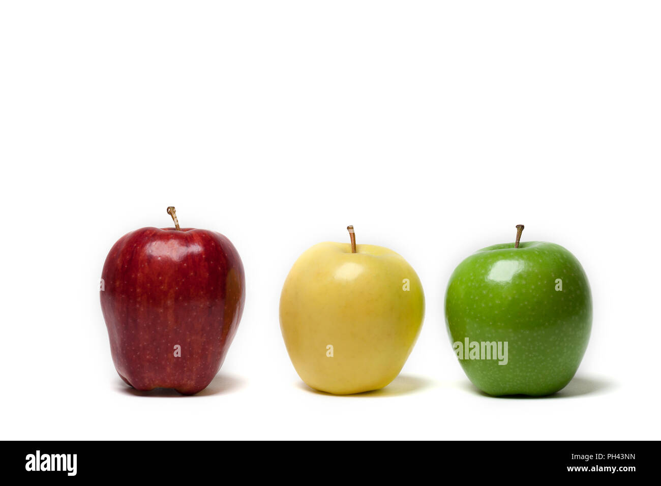 Three apples on a white background colors like a stoplight - Stock Image