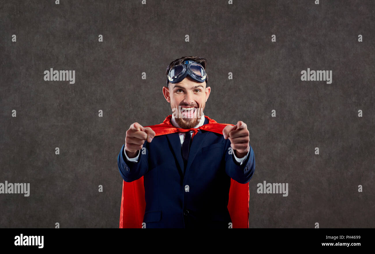 A businessman in a superhero costume is a winner.  - Stock Image