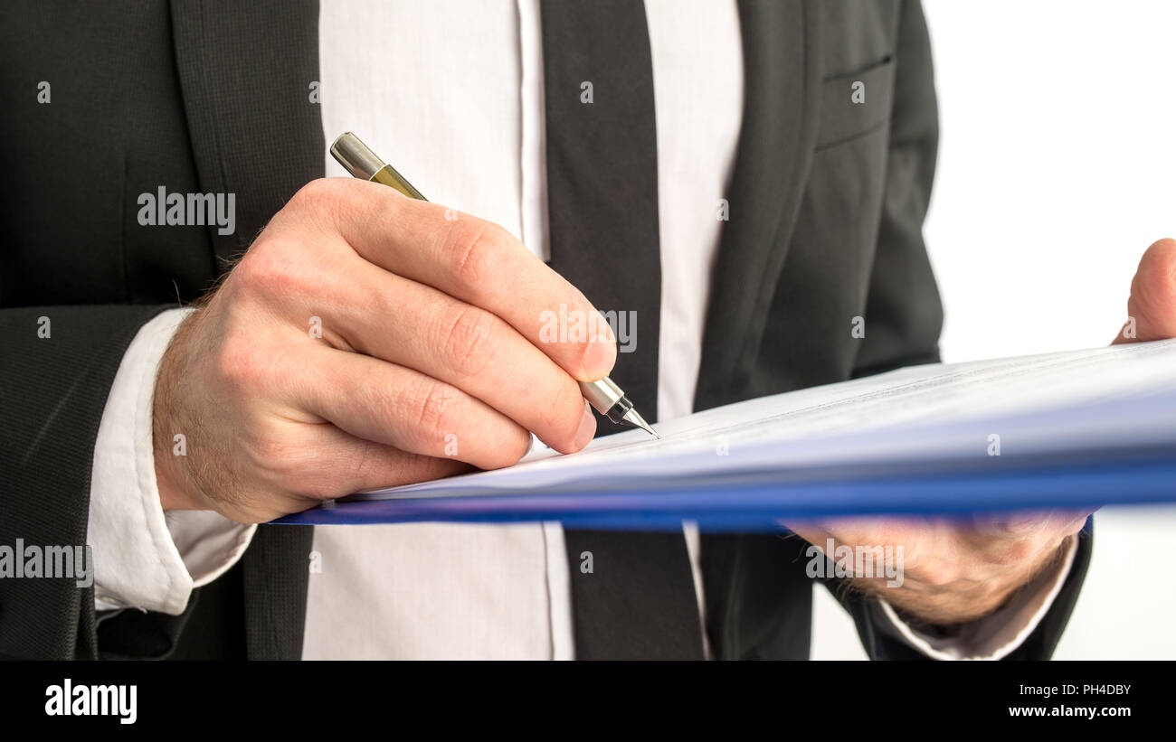Closeup Of Business Man Signing Legal Document On A Map Stock Photo - Signing legal documents