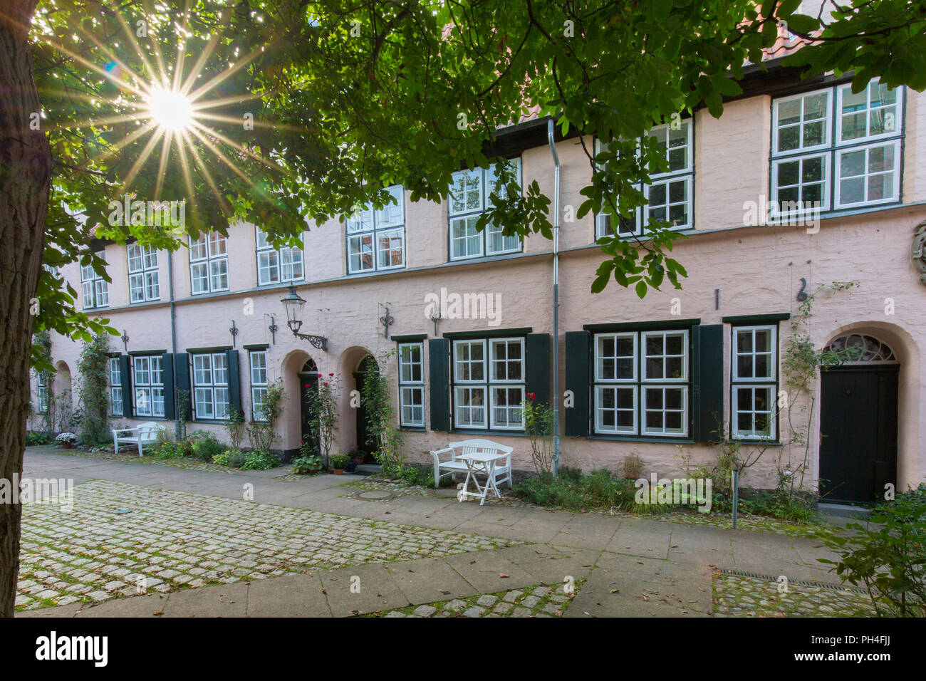 Early baroque Fuechtingshof, one of the most quaint and impressive of Luebecks foundation courts. Hansestadt Luebeck, Schleswig-Holstein, Deutschland - Stock Image