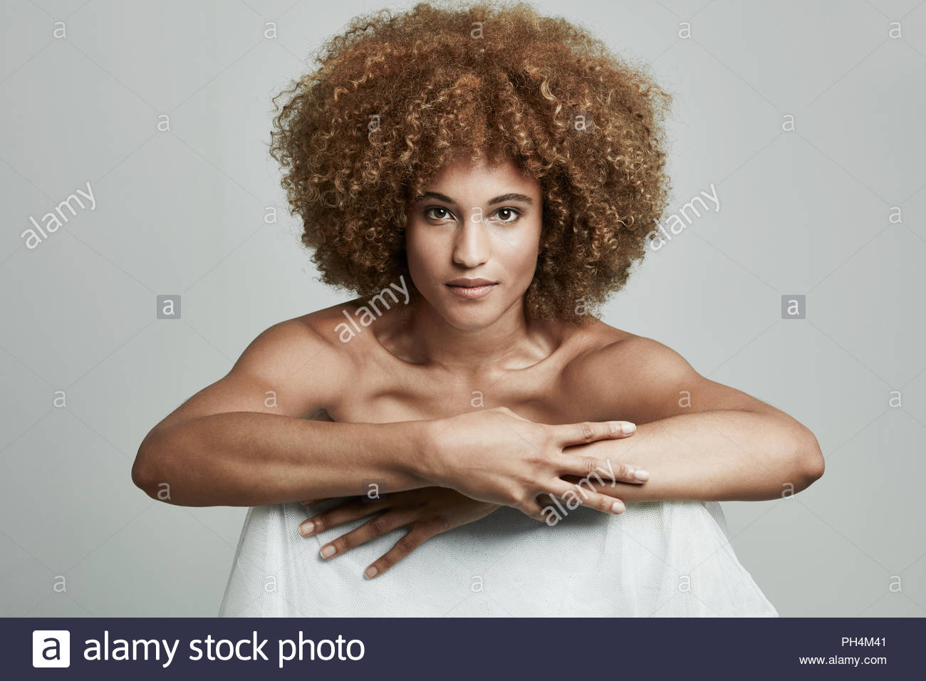 Young woman with afro - Stock Image
