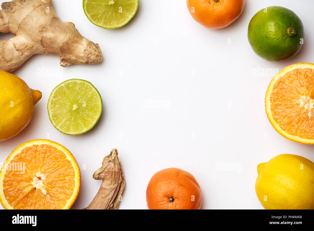 Image of ginger, lemon, oranges on white background - Stock Image