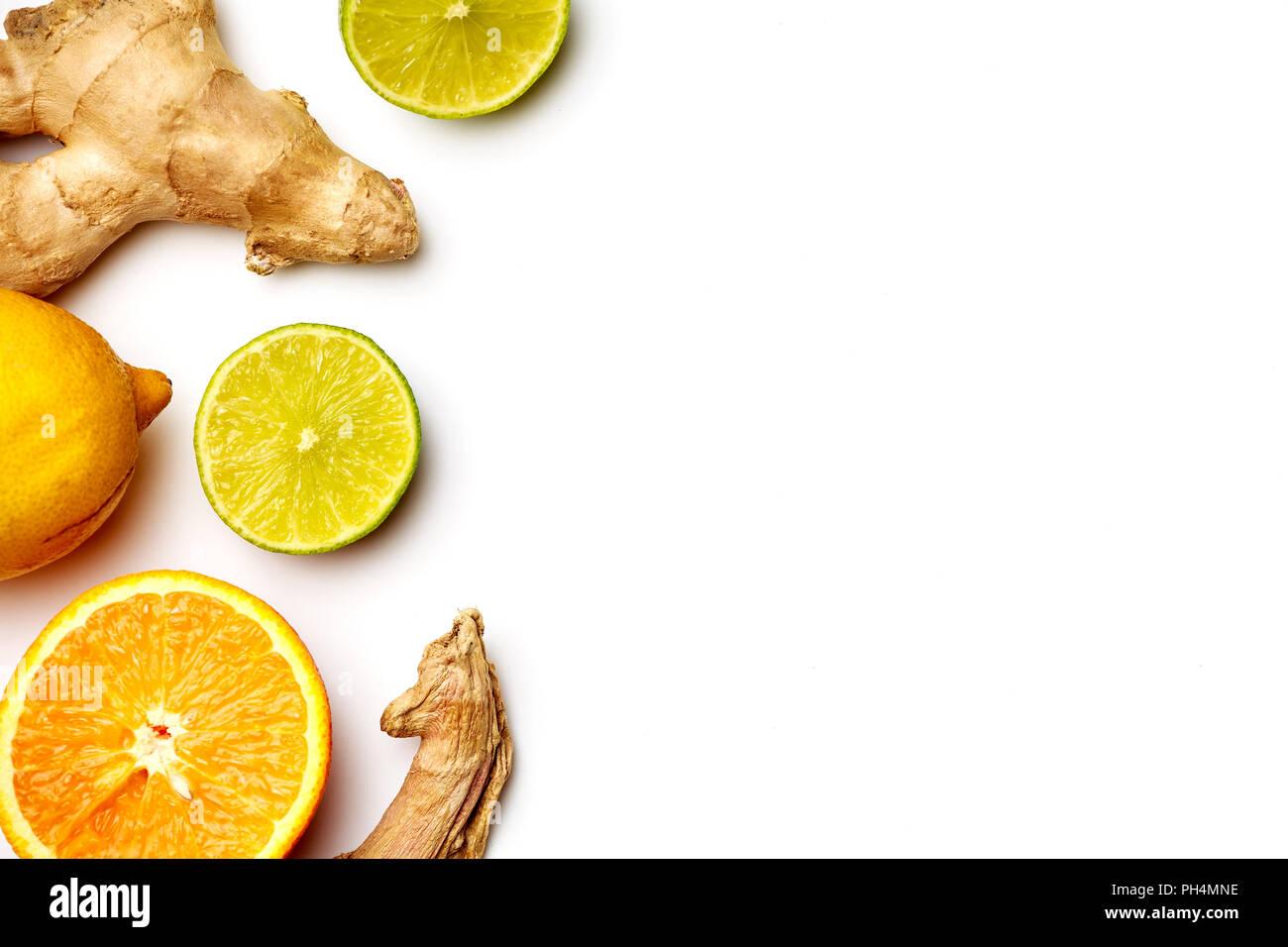 Photo of ginger, lemon, oranges on white background - Stock Image