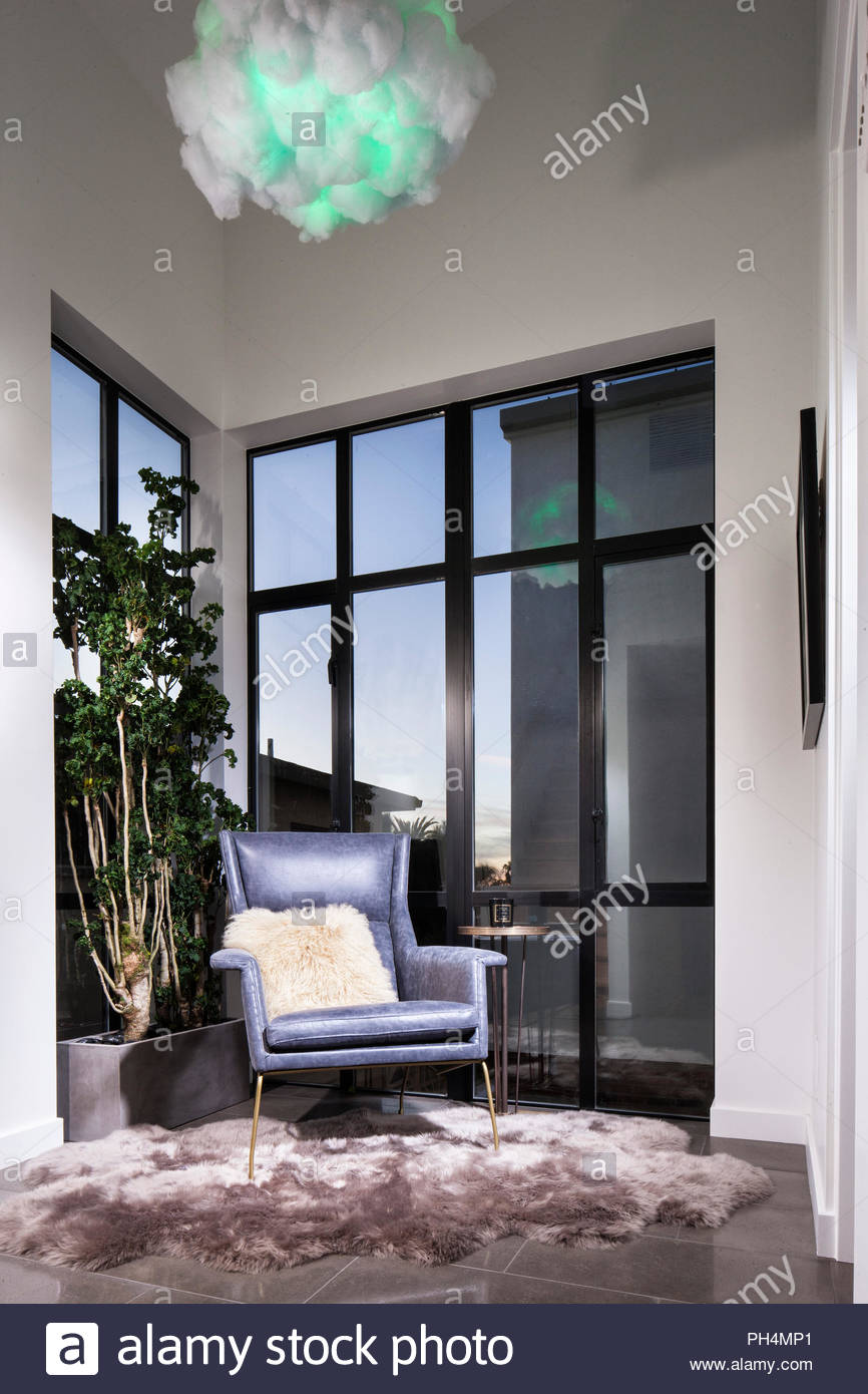 Fur cushion on armchair - Stock Image
