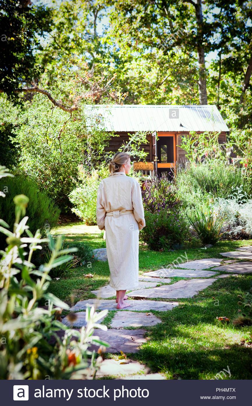 Woman wearing robe in garden - Stock Image