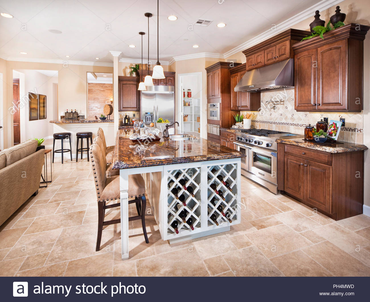 Brown kitchen with stools - Stock Image