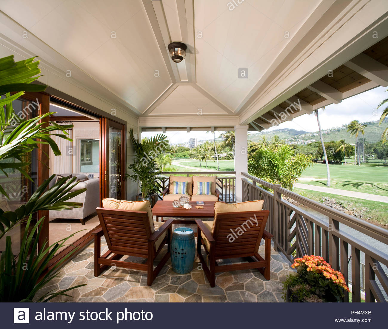 Dining area on balcony - Stock Image