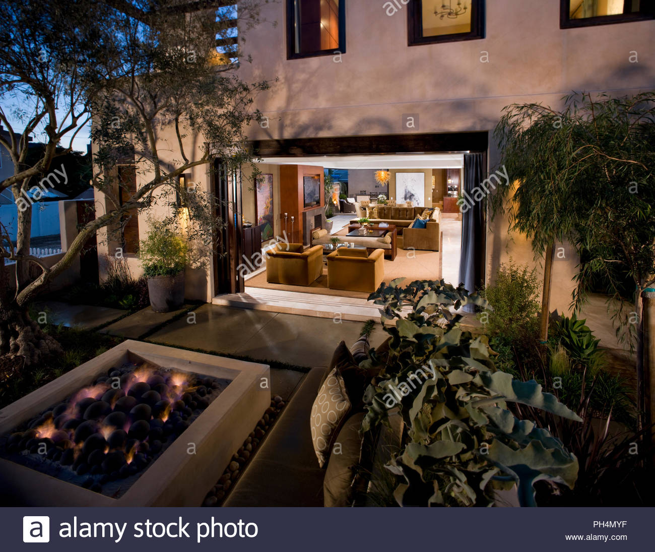Firepit on patio at sunset - Stock Image