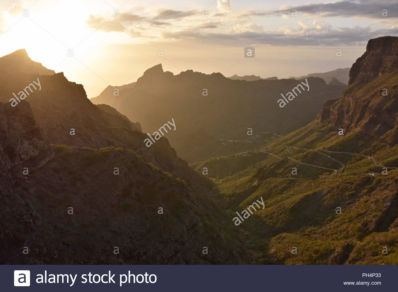 Masca Valley in the northwest of Tenerife Canary Islands Spain. Sun setting behind volcanic peaks of Teno Massif. Scenic view from Mirador de Cherfe. Stock Photo