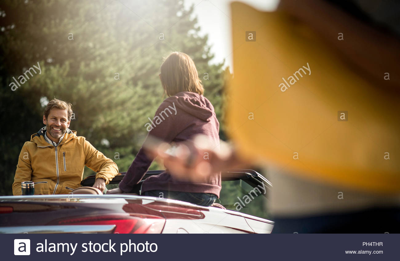 People by convertible car - Stock Image