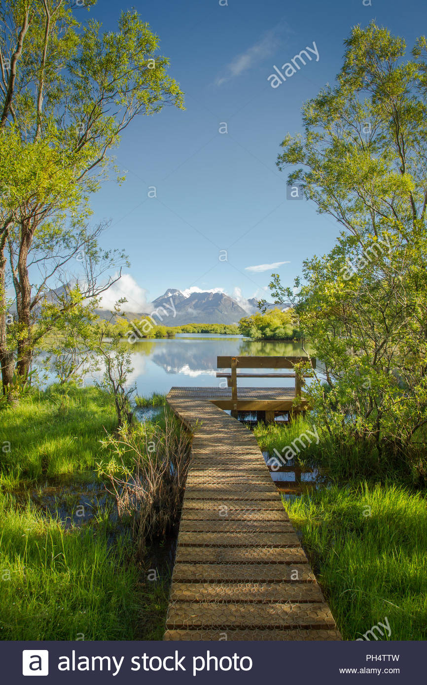 Boardwalk by Glenorchy Lagoon in New Zealand - Stock Image