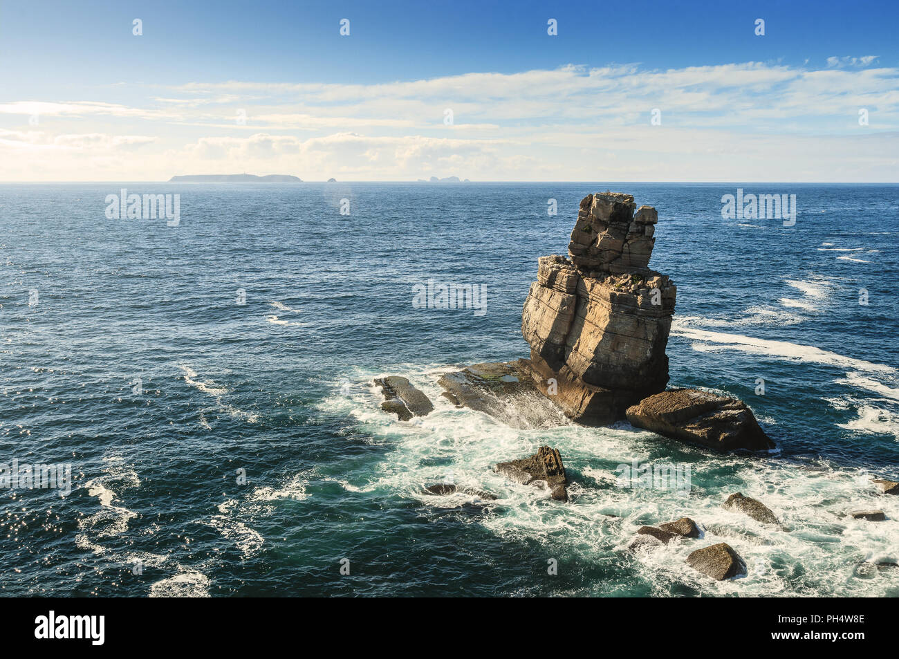 View from Cape Carvoeiro of the rock formation Nau dos Corvos and the sea near Peniche in Portugal, with the Berlengas islands in the background, in a - Stock Image