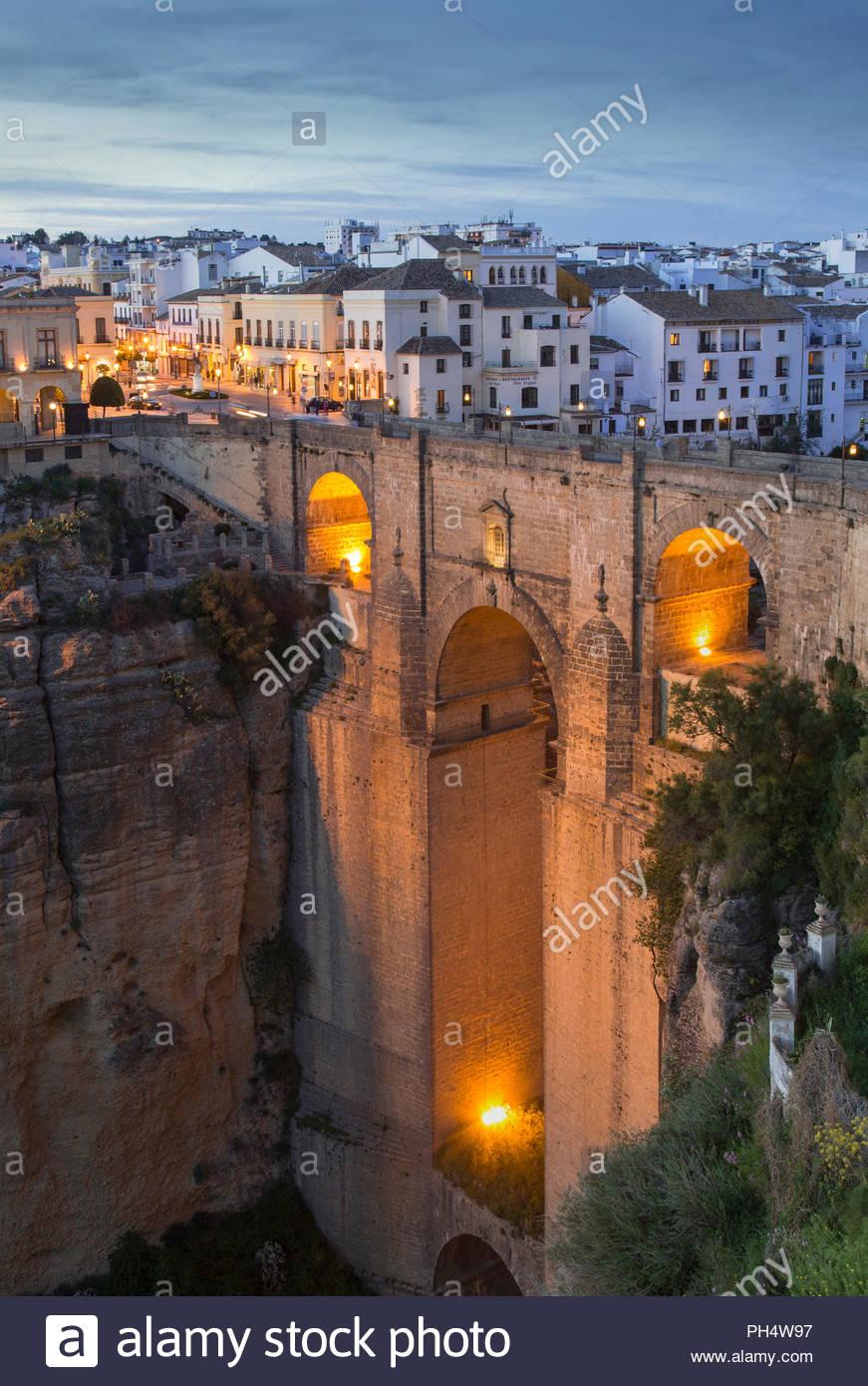 Puente Nuevo bridge at sunset in Ronda, Spain - Stock Image
