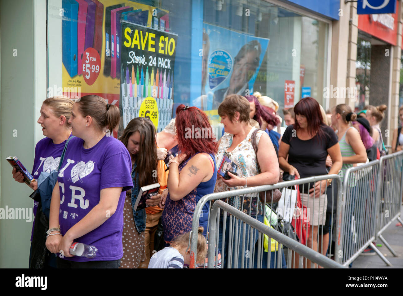 People queueing to meet magician Dynamo appearing at WH Smith in Sheffield, South Yorkshire, England Stock Photo