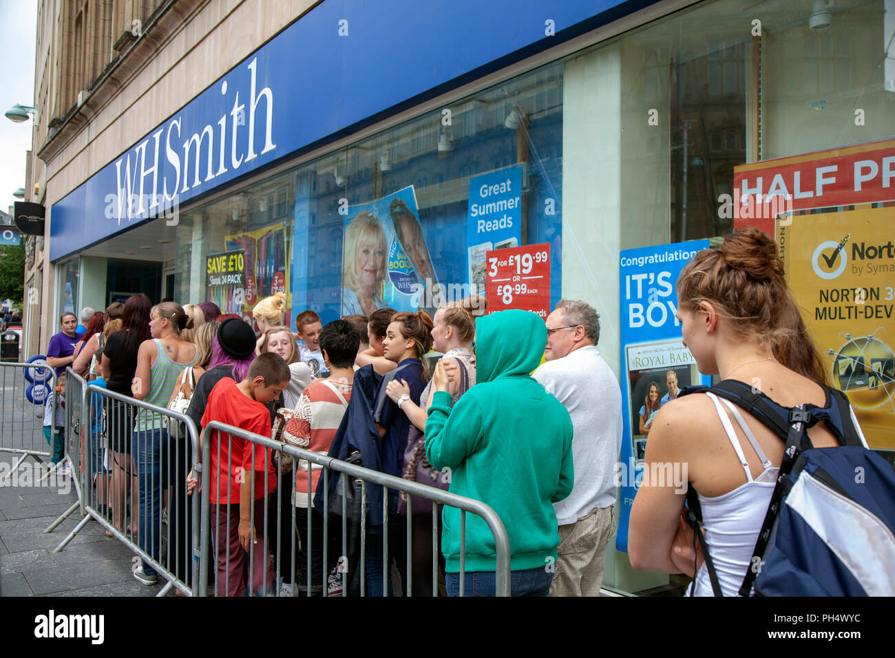 People queueing to meet magician Dynamo appearing at WH Smith in Sheffield, South Yorkshire, England - Stock Image