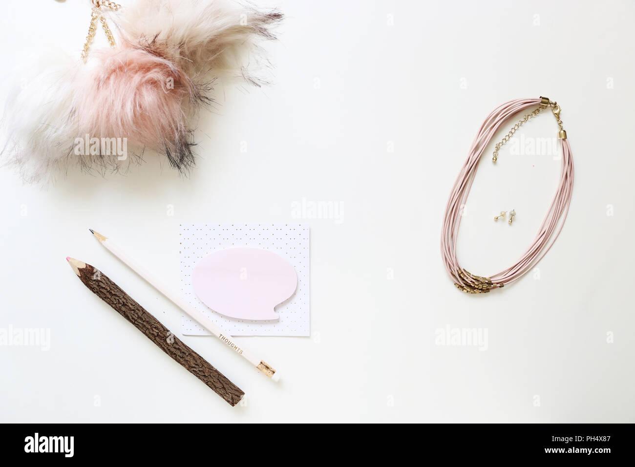 White and Pink Tones Flatlay on Desk - Stock Image