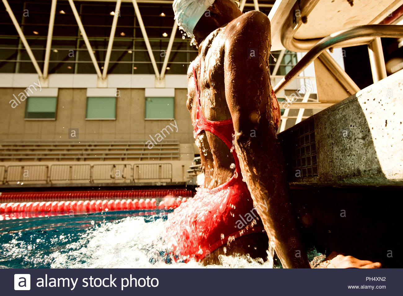 Underwater view of woman in swimming pool - Stock Image
