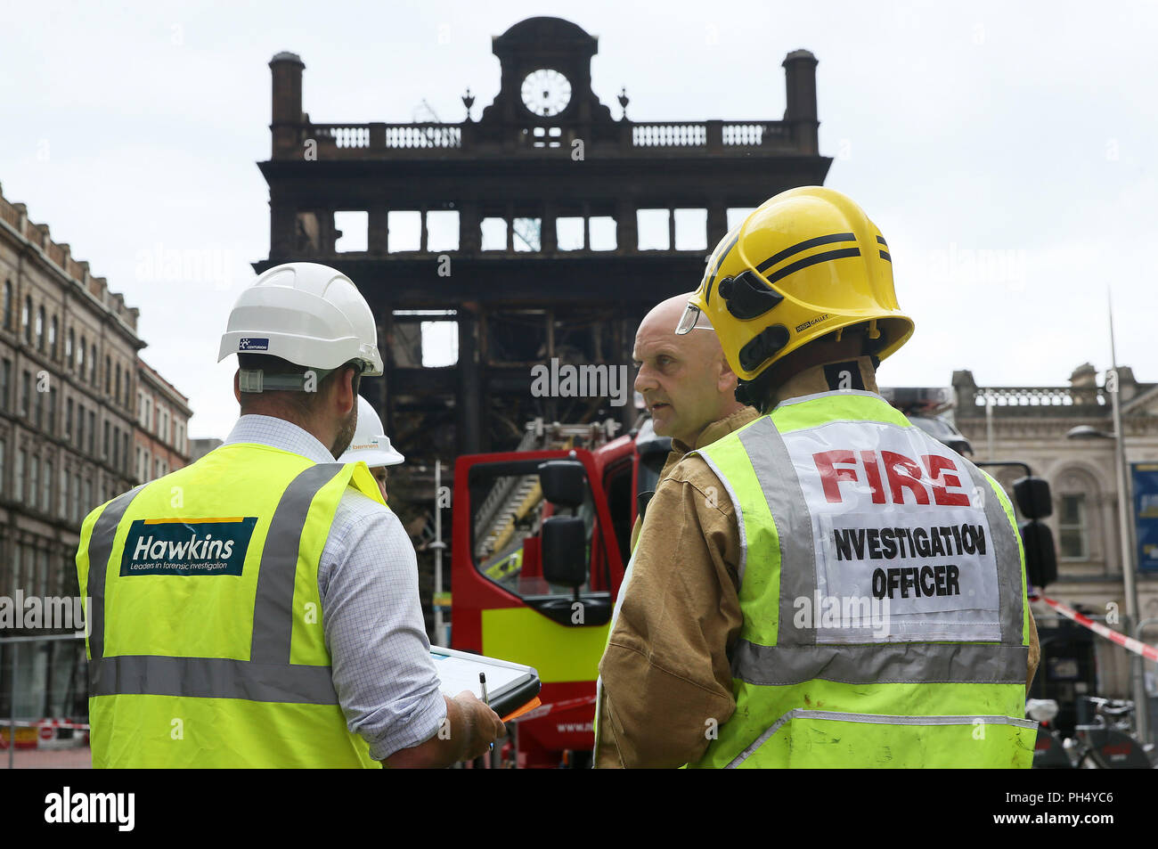 A Fire investigation officer at the historic five-storey Bank Buildings in Belfast city centre, where a major blaze broke out in the Primark store on Tuesday. - Stock Image