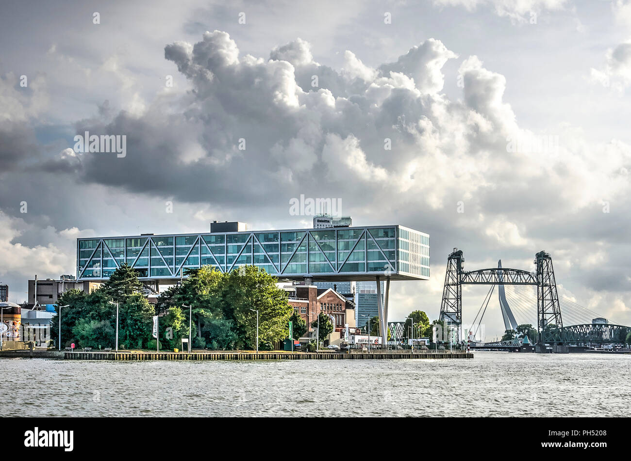 Rotterdam, The Netherlands, August 13, 2018: the striking horizontal beam of the Unilever office and monumental railway bridge De Hef, as seen from th - Stock Image