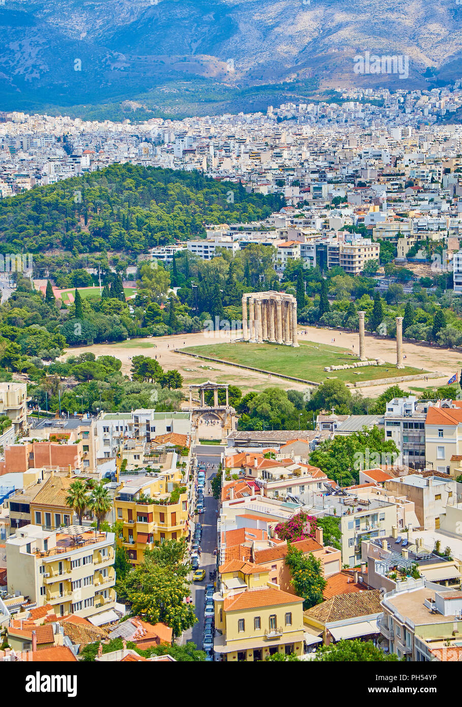 Temple of Olympian Zeus, monumental sanctuary dedicated to Zeus, with Lisikratous avenue and Hadrian's arch in foreground. View from the Acropolis of  - Stock Image