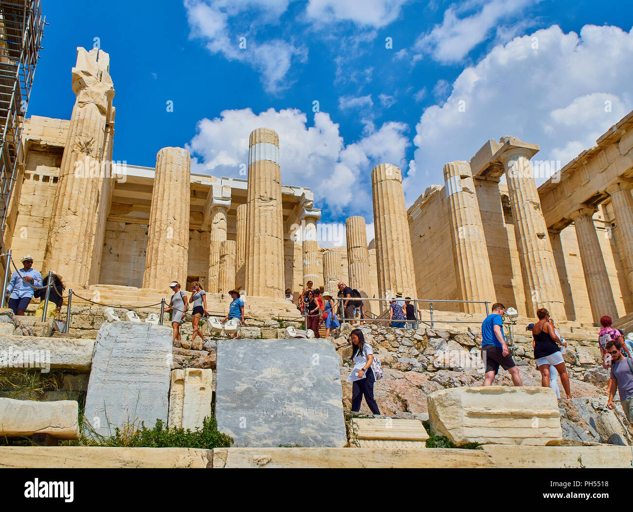 Athens, Greece - July 1, 2018. Tourists crossing the western side of Propylaea, the ancient gateway to the Athenian Acropolis. Athens. Attica, Greece. - Stock Image