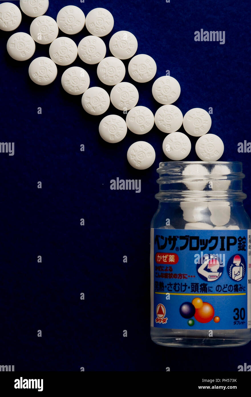 Pills for flu-like symptoms marketed by Takeda Pharmeceutical Co., Ltd., are arranged for a photo in Tokyo on Tuesday, July 31, 2007. Photographer:Rob - Stock Image