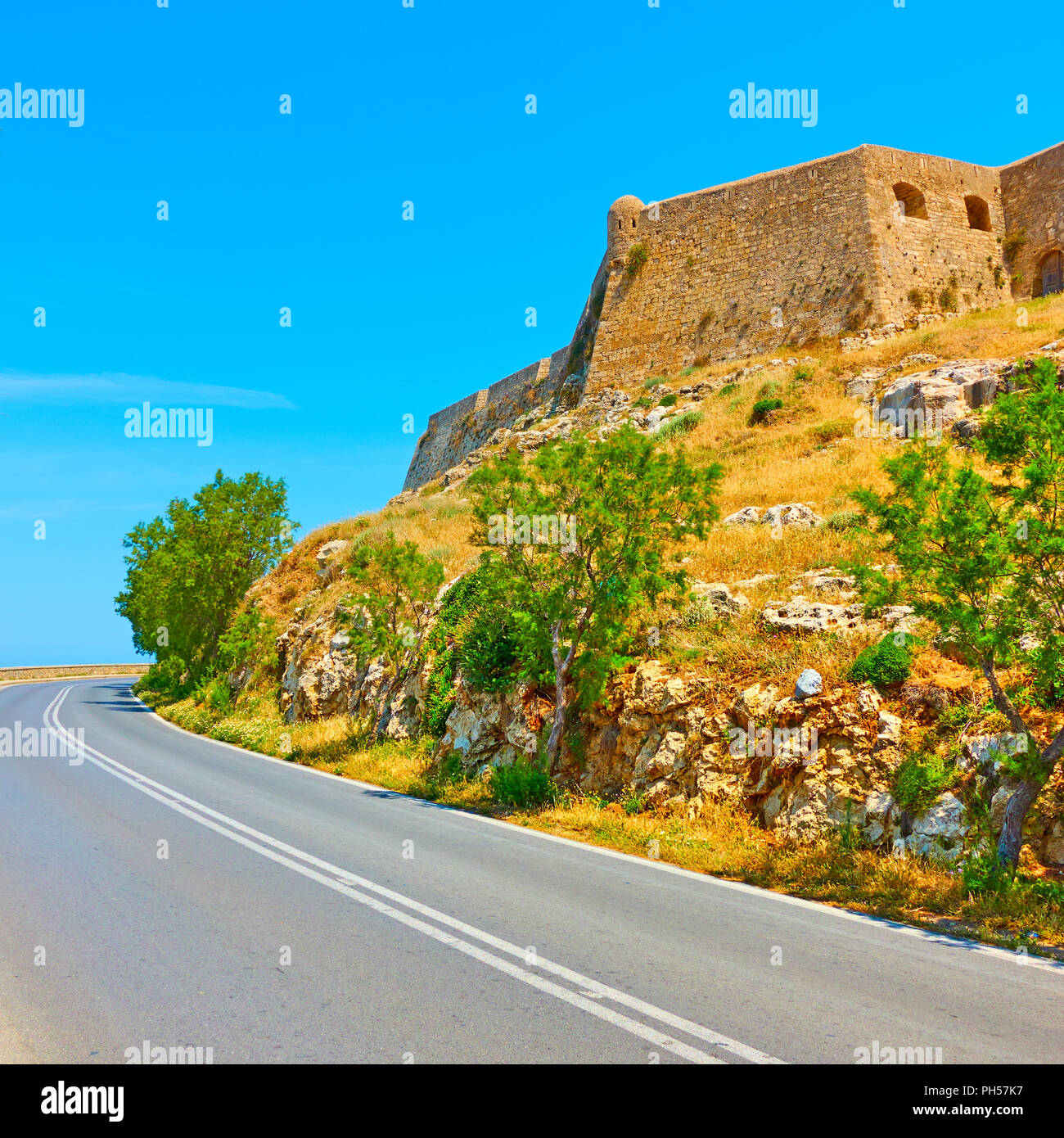 Road turn and the fortezza of Rethymno, Crete, Greece Stock Photo