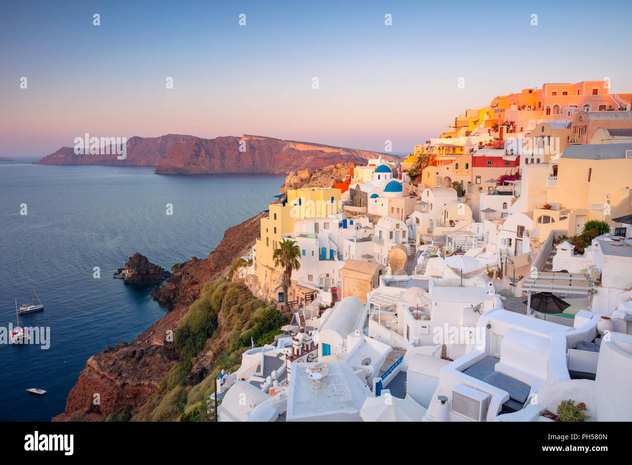 Oia, Santorini. Image of famous village Oia located at one of Cyclades island of Santorini, South Aegean, Greece. - Stock Image