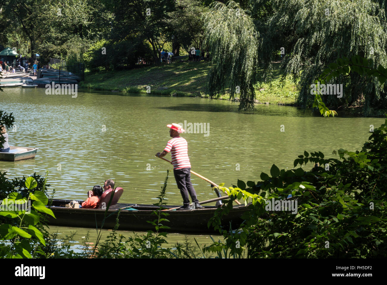 Visitors enjoy boating on the Lake in Central Park, NYC, USA - Stock Image