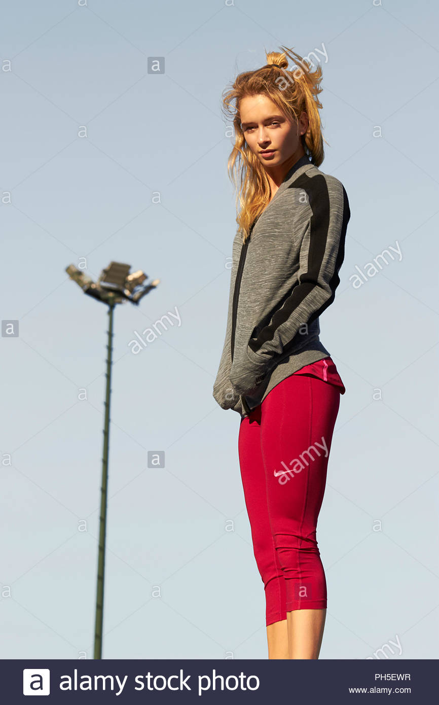 Young woman wearing grey jacket and red tights Stock Photo