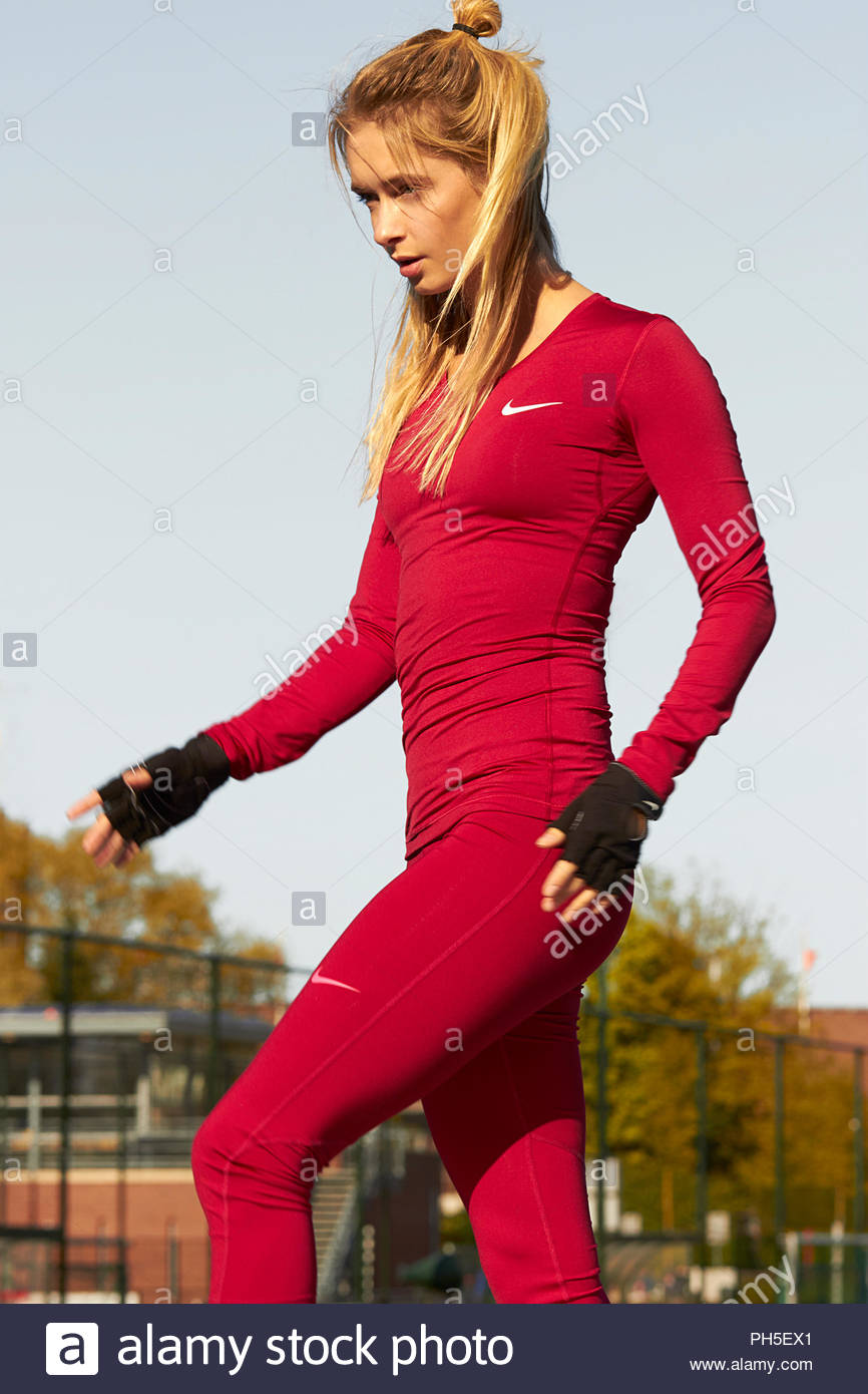 Young woman in red sportswear Stock Photo