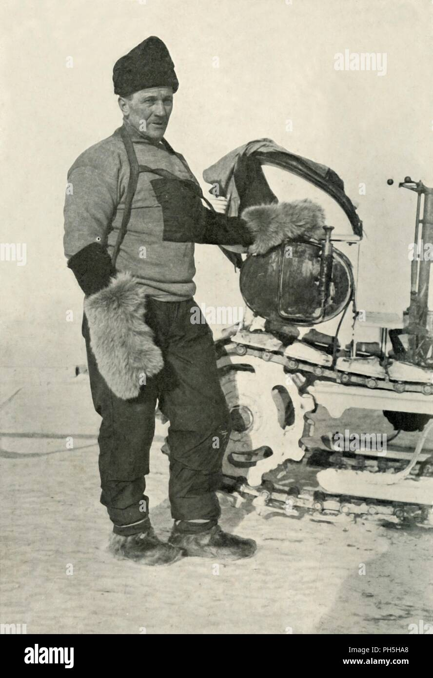 'Chief Stoker Lashly (Who received the Albert Medal)', 1911, (1913). William Lashly (1867-1940) standing next to a motor sledge. He was awarded the Albert Medal for saving the life of fellow expedition member Edward Evans. The final expedition of British Antarctic explorer Captain Robert Falcon Scott (1868-1912) left London on 1 June 1910 bound for the South Pole. The Terra Nova Expedition, officially the British Antarctic Expedition (1910-1913), included a geologist, a zoologist, a surgeon, a photographer, an engineer, a ski expert, a meteorologist and a physicist among others. Scott wished t - Stock Image