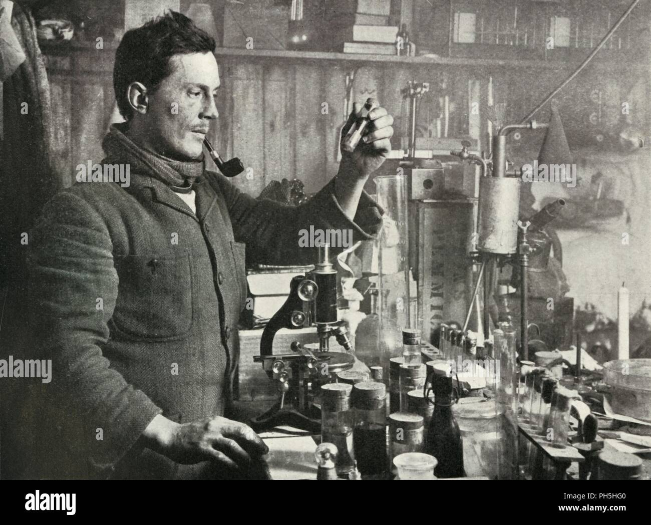 'Dr. Atkinson in his Laboratory', 15 September 1911, (1913). Surgeon and parasitologist Edward Atkinson (1881-1929) led the party which found the tent with the bodies of Scott,  Bowers and Wilson. The final expedition of British Antarctic explorer Captain Robert Falcon Scott (1868-1912) left London on 1 June 1910 bound for the South Pole. The Terra Nova Expedition, officially the British Antarctic Expedition (1910-1913), included a geologist, a zoologist, a surgeon, a photographer, an engineer, a ski expert, a meteorologist and a physicist among others. Scott wished to continue the scientific  - Stock Image