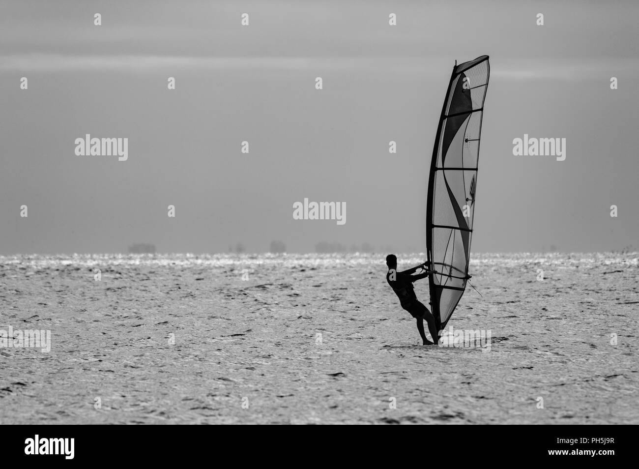 Lone Wind Surfer - Stock Image