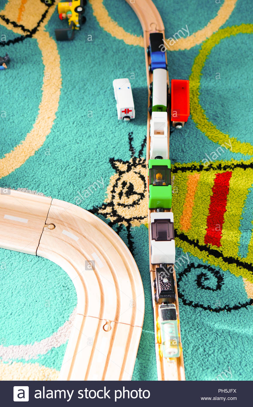 Toy locomotive with wagon on a wooden tack from aerial perspective Stock Photo