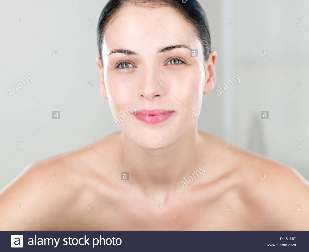 Portrait of young woman in natural condition - Stock Image