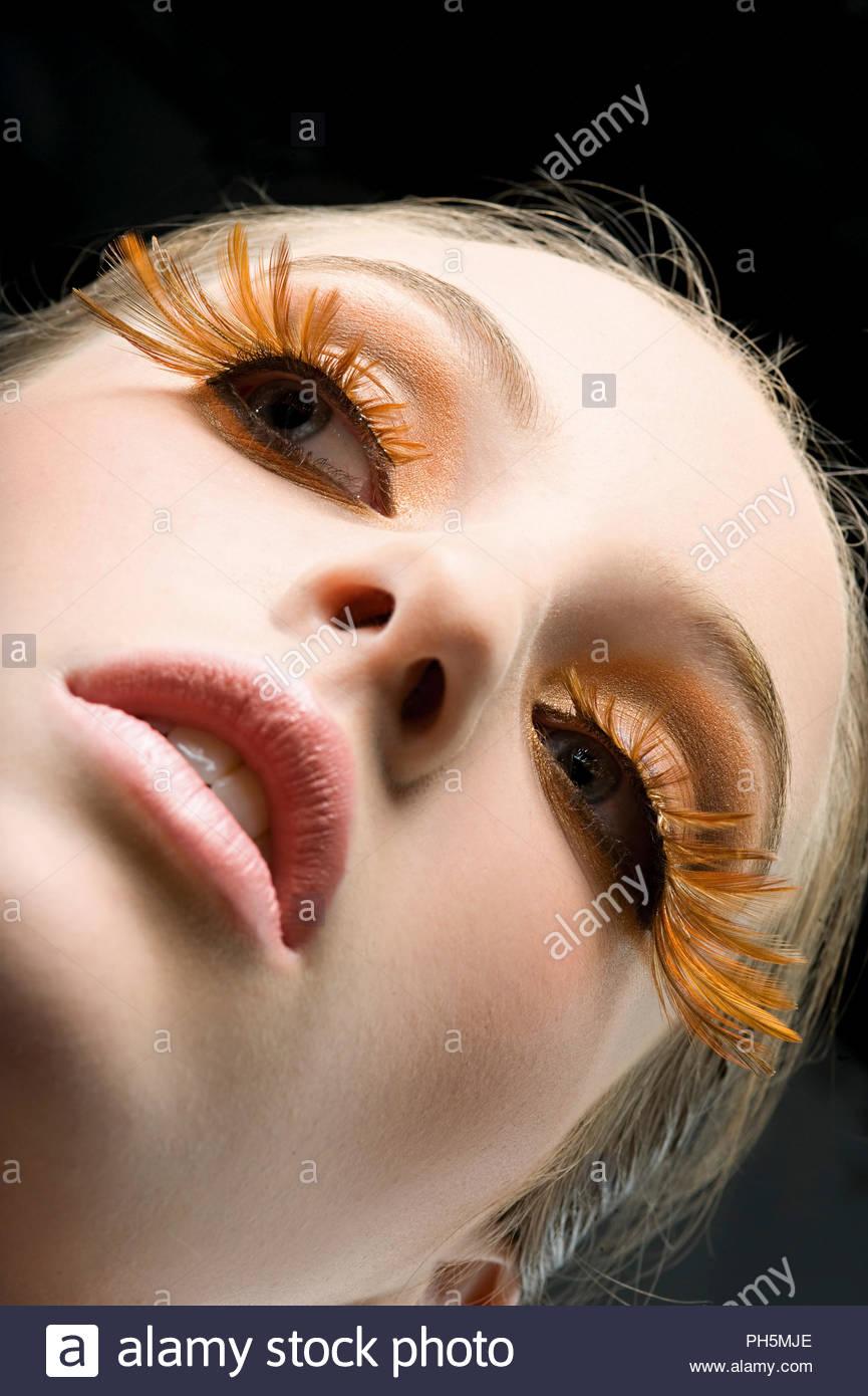 Young woman with false eyelashes - Stock Image