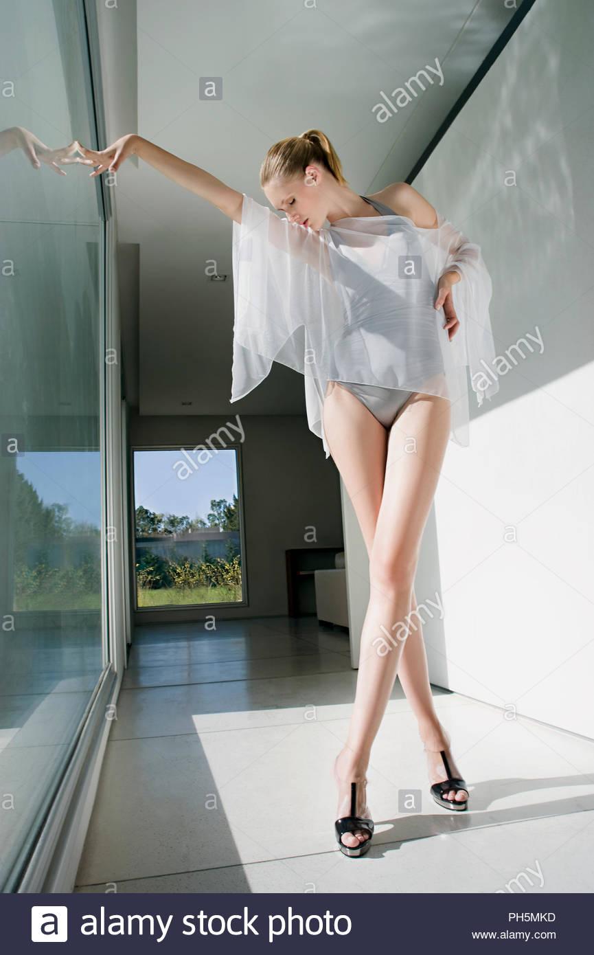 Model posing inside modern house - Stock Image